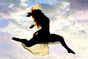 Woman Leaping Through The Air